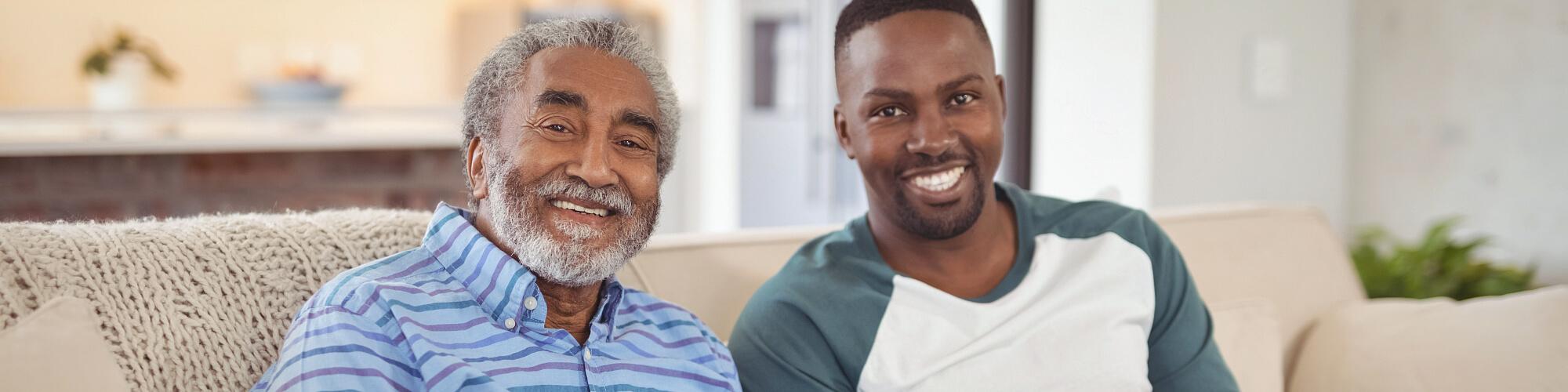 caregiver and senior man smiliing